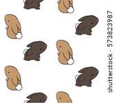 cute cartoon brown rabbits on a ... | Shutterstock .eps vector #573823987