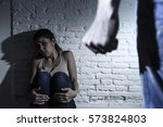 Small photo of young couple in problems with drunk husband or man attacking and threatening wife or girl crying on the floor scared and terrified in domestic violence and cruel abuse of women