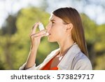 woman using asthma inhaler in a ... | Shutterstock . vector #573829717