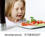cute little girl with salad and ...