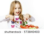 cute little girl with plate of...