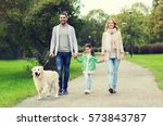 Stock photo family pet domestic animal and people concept happy family with labrador retriever dog walking 573843787