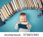 one year old baby among books... | Shutterstock . vector #573851983