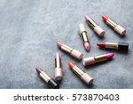 colorful lipsticks on grey... | Shutterstock . vector #573870403
