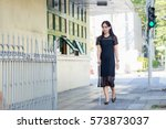 blind woman walking on sidewalk | Shutterstock . vector #573873037