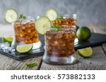 rum and cola cocktail in... | Shutterstock . vector #573882133