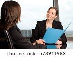 financial adviser talking with... | Shutterstock . vector #573911983