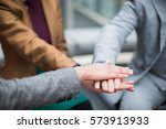 business people join hands... | Shutterstock . vector #573913933