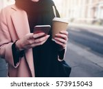 young woman holding a coffee... | Shutterstock . vector #573915043
