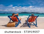 couple on tropical beach in... | Shutterstock . vector #573919057