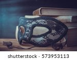 Book And A Mask