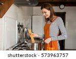 woman cooking in kitchen | Shutterstock . vector #573963757