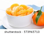 whole tangerine with peeled...   Shutterstock . vector #573965713