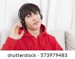 teenage boy listening to...   Shutterstock . vector #573979483