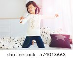 cute happy girl singing into... | Shutterstock . vector #574018663