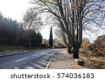 Small photo of LOURMARIN, FRANCE - NOVEMBER 22, 2014 : The road to Albert Camus Grave, Cemetery of Lourmarin. Entrance starts on the left sided tall tree. Provence-Alpes-Côte d'Azur.