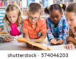 Kids Reading A Book In Library...