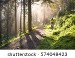 fog rider on a mountain bike... | Shutterstock . vector #574048423