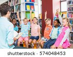 kids raising their hands in... | Shutterstock . vector #574048453