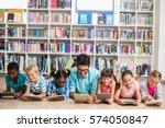 teacher and kids lying on floor ... | Shutterstock . vector #574050847