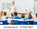 teacher teaching kids in... | Shutterstock . vector #574057807