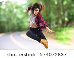 girl jumping in hip hop style... | Shutterstock . vector #574072837
