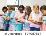 students using digital tablet... | Shutterstock . vector #574087897