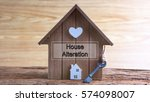 Small photo of Conceptual image of miniature home icon made from wood and word written HOUSE ALTERATION on wooden base.Selective focus.