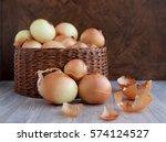 a lot of onions in a wicker box....   Shutterstock . vector #574124527