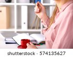 female hands holding cup of... | Shutterstock . vector #574135627