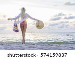 Blonde Woman On The Beach At...