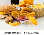 junk food on white table. fast...   Shutterstock . vector #574183903