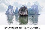 Small photo of Tourist junks floating among limestone rocks at Ha Long Bay, South China Sea, Vietnam, Southeast Asia