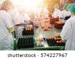 employee egg farm moving eggs... | Shutterstock . vector #574227967