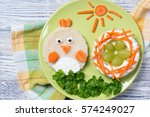 funny toast in a shape of chick ... | Shutterstock . vector #574249027