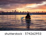 Stock photo kayaking around vancouver downtown bc canada during a beautiful winter sunrise 574262953