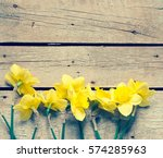 Spring Flowers On A Wooden...