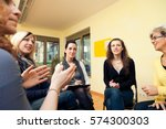 group of women sitting in a... | Shutterstock . vector #574300303