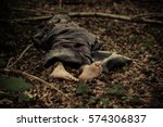 dead body of a barefoot... | Shutterstock . vector #574306837
