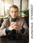 Small photo of Confident businessman portrait - stern look