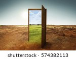open wooden door to the new... | Shutterstock . vector #574382113