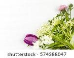 purple tulip white narcissus...   Shutterstock . vector #574388047
