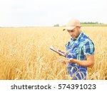 farmer in a plaid shirt... | Shutterstock . vector #574391023