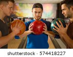 main game. three handsome young ... | Shutterstock . vector #574418227