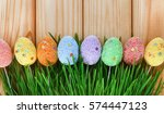 easter eggs in green grass on a ... | Shutterstock . vector #574447123