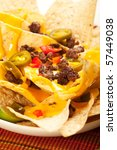 Nachos with beef, onions, peppers, and jalapeno and olive - stock photo
