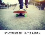 young skateboarder legs riding... | Shutterstock . vector #574512553