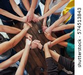 Small photo of Group of Diverse Hands Together Joining. Concept of teamwork and friendship.