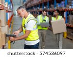 focus of worker is working on... | Shutterstock . vector #574536097