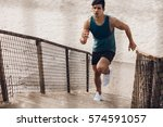 fitness man running up the... | Shutterstock . vector #574591057